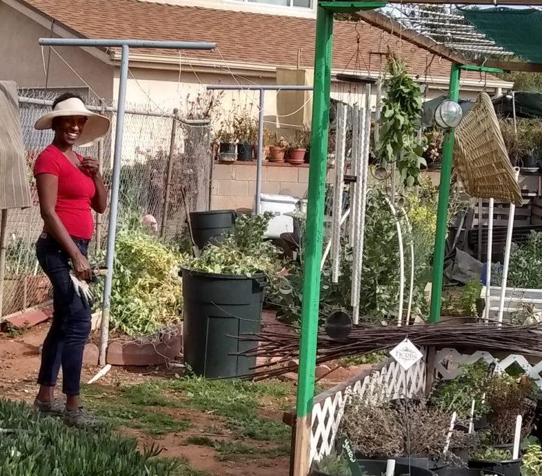 Mia Vaughnes working in Jeeni's garden