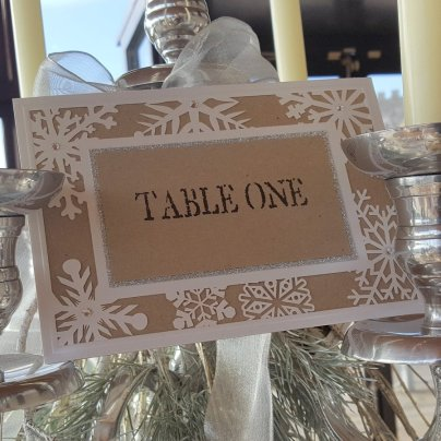 Kraft & laser cut snowflake table number