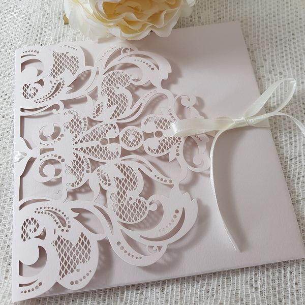 pale pink laser cut pocketfold invitation