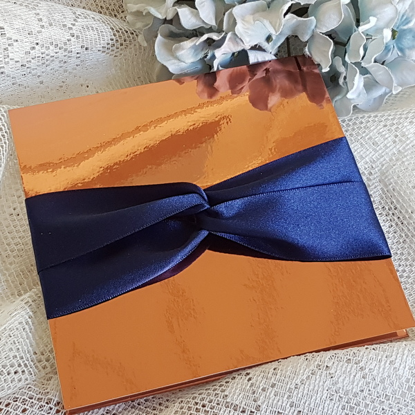 copper pocketfold invitation with navy ribbon