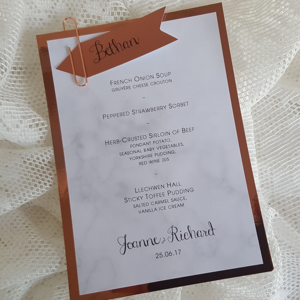 copper and marble wedding menu with guest name tag