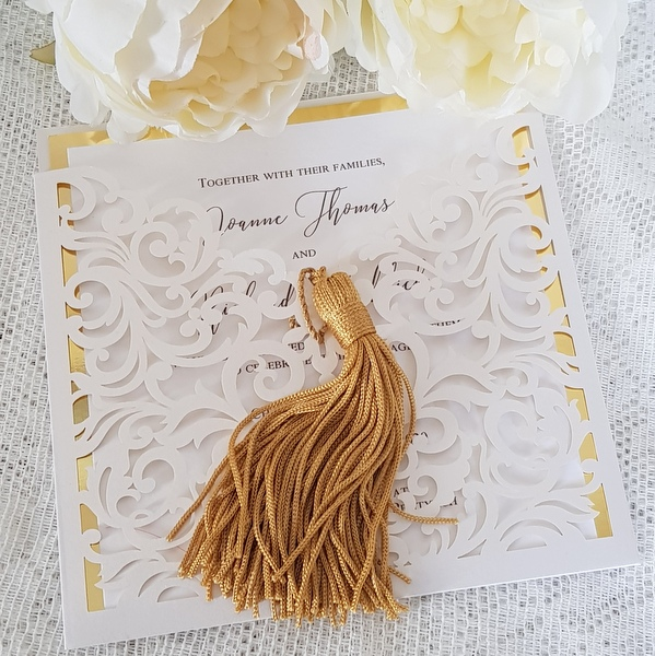 laser cut wallet invitation with gold tassel