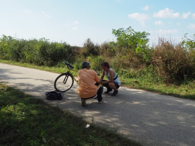 Helping a local with a broken tyre