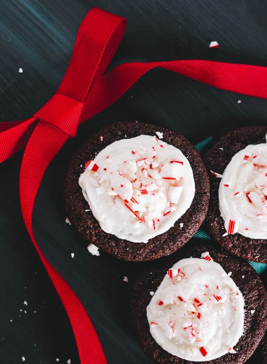 chocolate peppermint cookies on dark backdrop with red bow