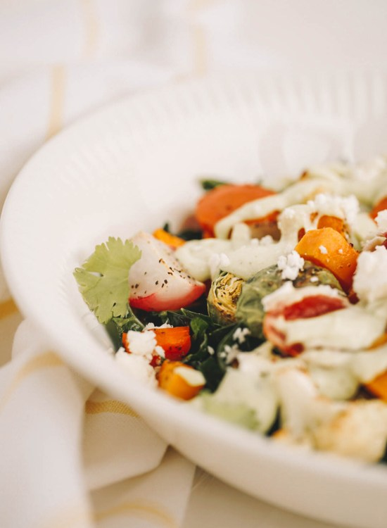 roasted vegetable salad in white salad bowl on dishcloth