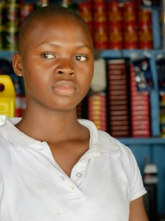 close up of a woman at a shop, Ghana