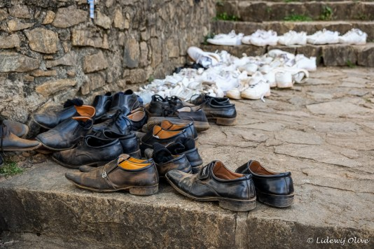 All the school children had to take off their shoes before entering the temple. The shoes are part of the uniform.