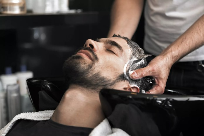 man getting his hair washed at the salon
