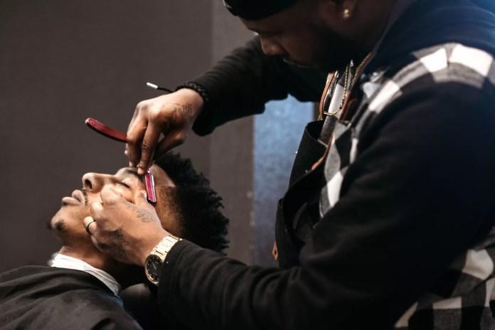 Man getting a trim at a barbershop