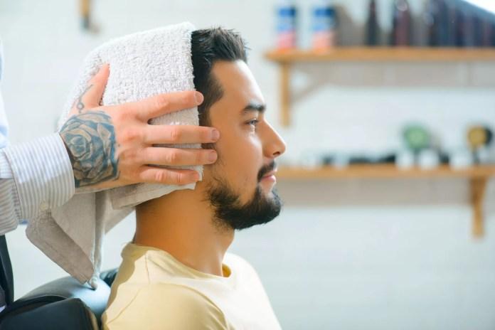 man getting his hair towel dried
