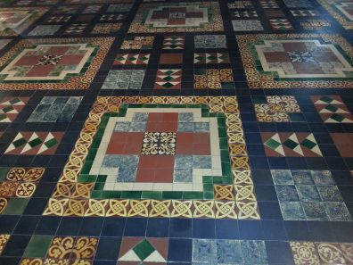 The floor throughout is intricately designed and so colorful!