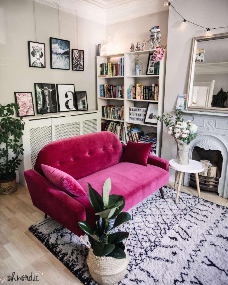 Pink sofa in a neutral room