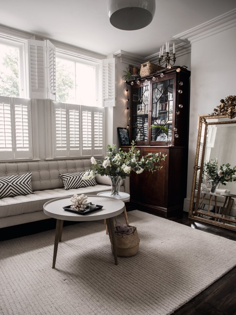 vintage cupboard with a modern white sofa