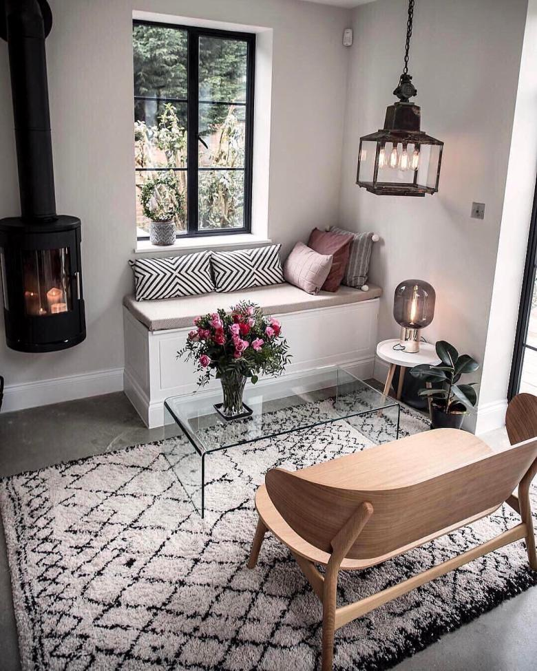 Seating area with a vintage street lamp and wall hung wood burner