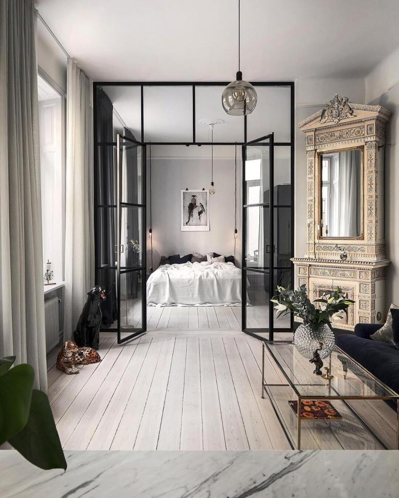 Scandinavian apartment with tall wood burning stove and Crittal style glazing