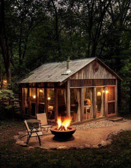 cute little wooden cabin with a big windows