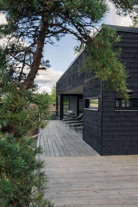 beautiful black house and wooden decking