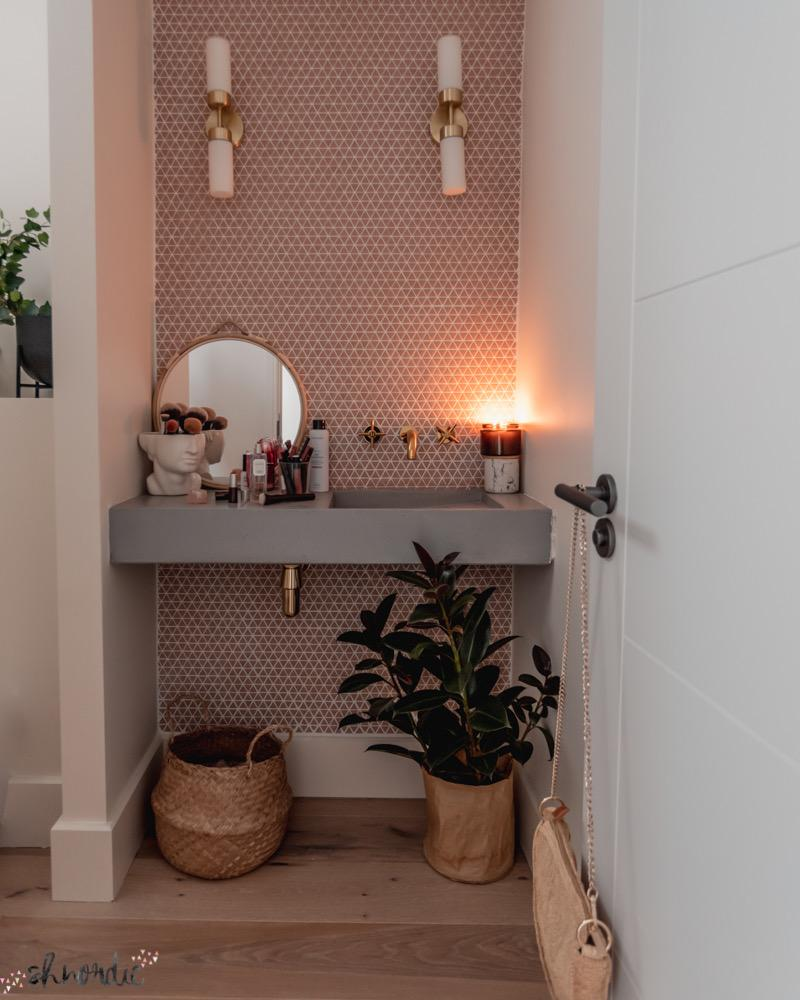 pink and concrete cloakroom