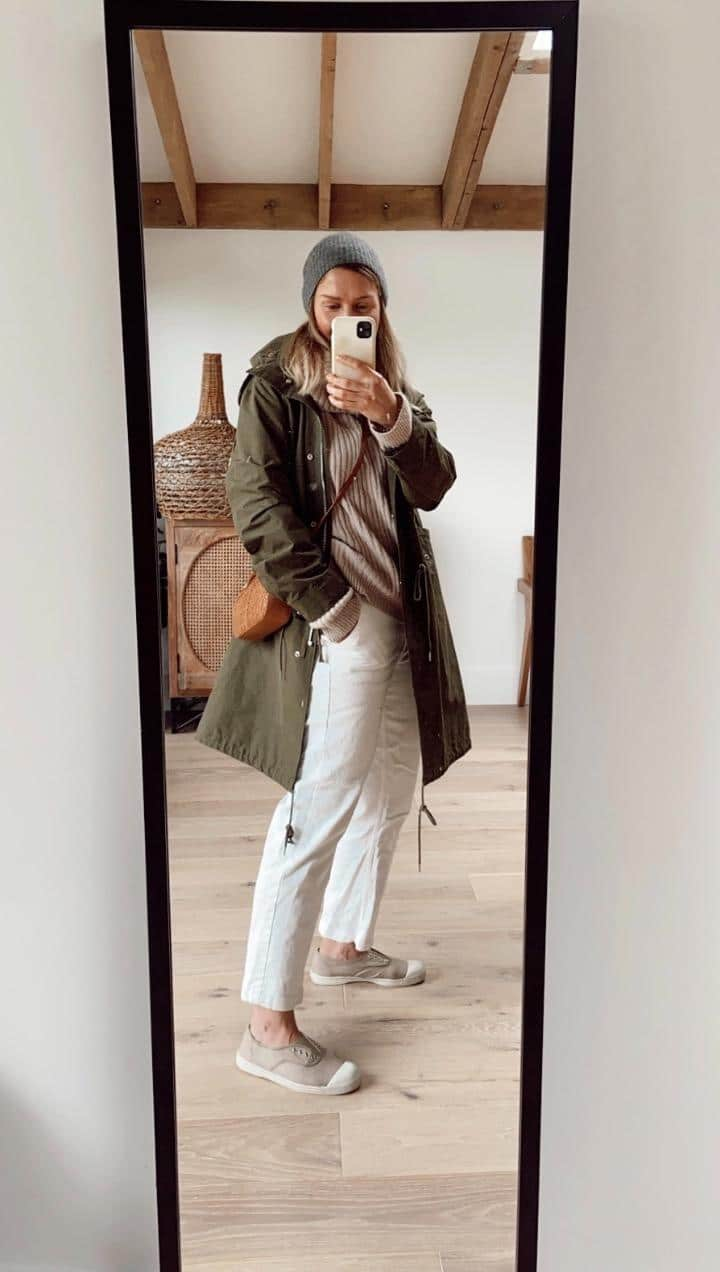 outfit with white jeans and green rain parka