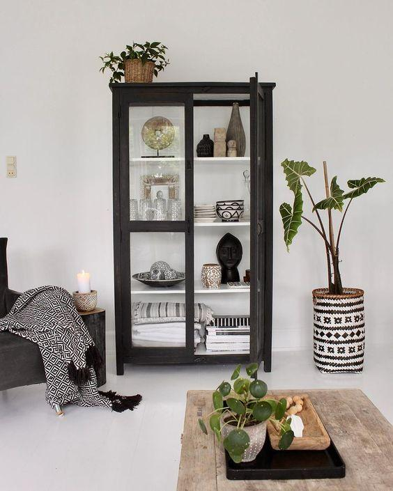 black wooden display cabinet in a Scandi living room