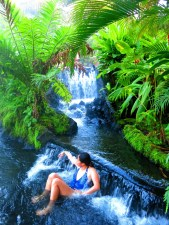 Woman relaxing in the hot springs at Tabacon