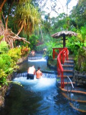 People enjoying the hot springs at Tabacon