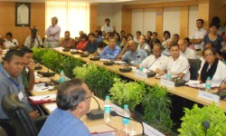 Prof. Udayon Misra deliberating on the background and core issues, participants are attentively listening