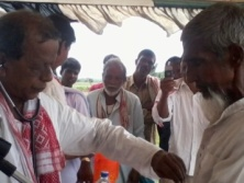 Dr. Bhumidhar Barman treating people.