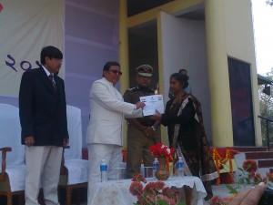 Sonitpur ANM Mrs Elizabeth Tigga being felicitated by state minister Tanka Rai Bahadur