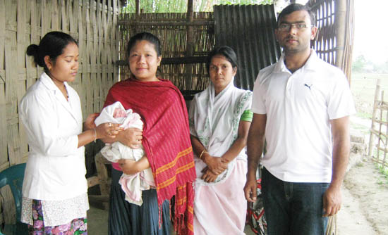 The Jorhat health team with the new born