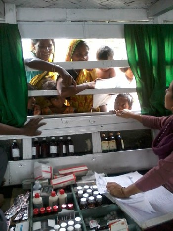 Medicines being dispensed to the beneficiaries from the Boat Clinic at Barpeta