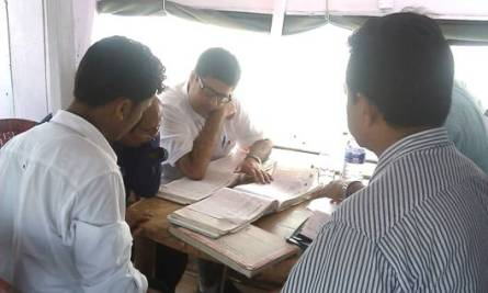 The MD going through the Kamrup Boat Clinic records