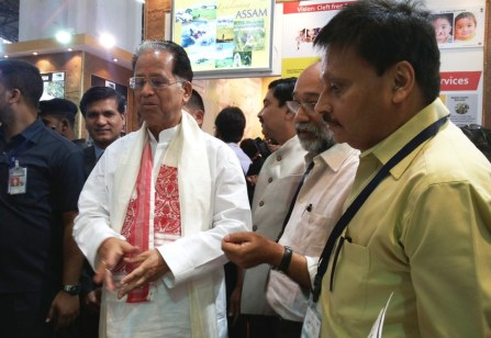 The Chief Minister of Assam with the Managing Trustee C-NES at the exhibition