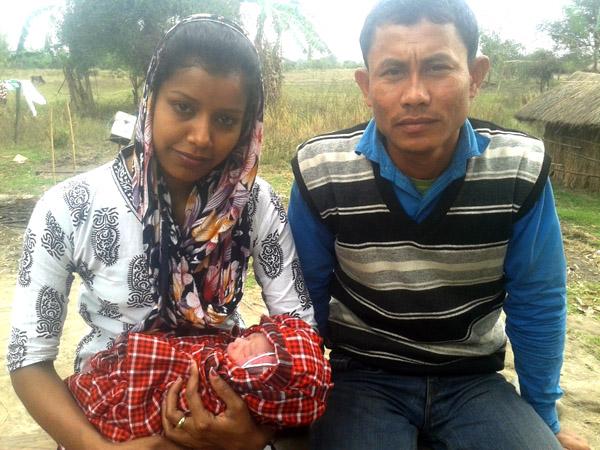 Nurse Junmoni and Indeswar Kumbang holding the new born baby