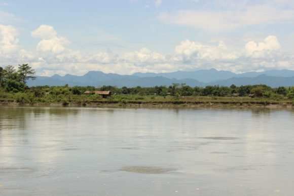 The mighty Brahmaputra, framed by the majestic Himalayan ranges of Arunachal Pradesh in the background as we sail along the sand bars in Assam's Dibrugarh District
