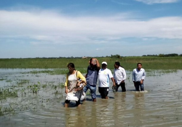 The Jorhat team wading through water to attend a health camp