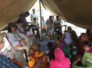The visitors interact with the beneficiaries during a health awareness session before the camp began
