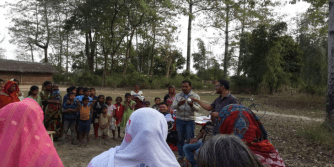 Community worker, Dhemaji Boat Clinic Punyeshwar Boruah informing the villagers about the benefits and importance of family planning