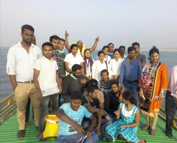 The Goalpara Boat Clinic team with members of the with District Health Society on board the boat clinic journeying to the camp