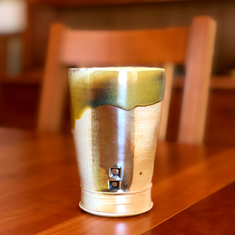Wood Fired Tumbler sitting on a table