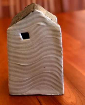 handmade ceramic decorative house with waves carved in the clay
