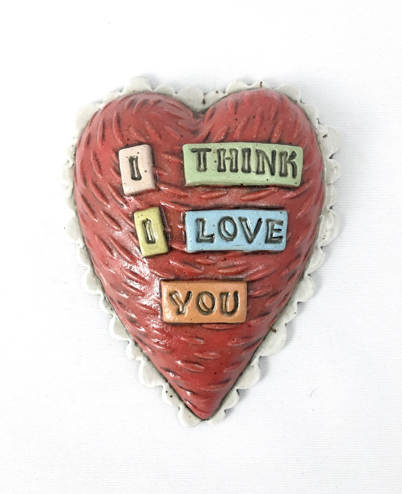 ceramic heart wall tile that says I think I love you