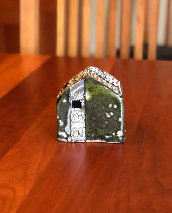 XS ceramic cottage, decorative, sitting on a table