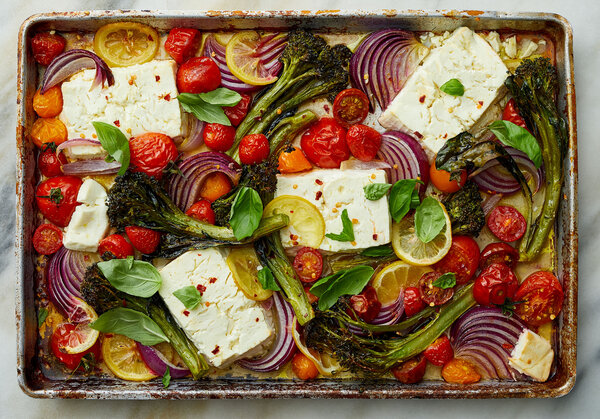 sheet pan with feta, tomatoes, broccolini, lemons and herbs