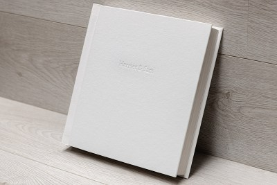 "Album - 12""x12"" - Material = White Leather Effect (36) - Debossing - Font = Times New Roman / 36pt"