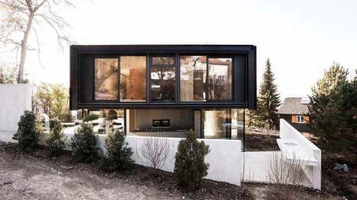 modern-house-riehen-made-glass-concrete-wood-metal-serve-designed-reuter-raeber-architects-02
