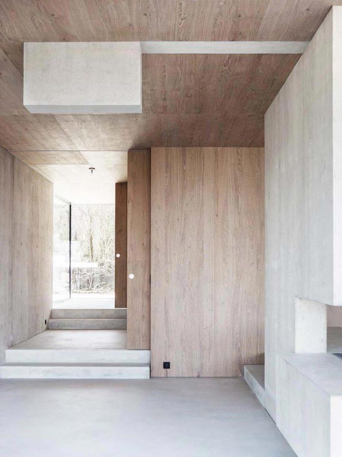 modern-house-riehen-made-glass-concrete-wood-metal-serve-designed-reuter-raeber-architects-07