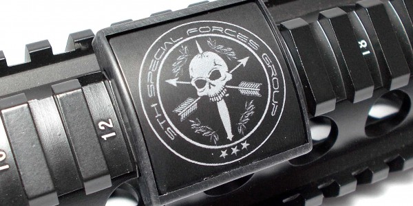 A 5th Group Emblem etched on a weapon.