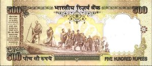 One of the notes that is now illegal to move. It features Mahatma Gandhi leading his followers.....but not to a bank to exchange the note.
