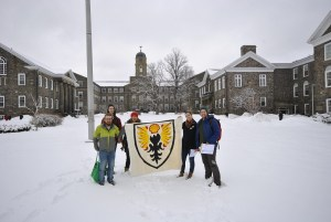 DivestDal members retouch the Dalhousie insignia to include the symbol of Shell Oil Corporation, in the interests of accuracy.